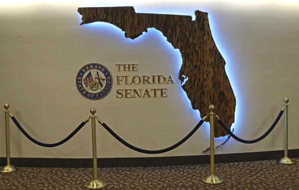 The Florida Senate remodeling includes this artwork on the fifth floor gallery photographed at the start of session on Tuesday Jan. 14, 2020, in Tallahassee, Fla. The Florida Senate on Tuesday unveiled a gleaming new piece of art at one of its most-visited corridors in the state Capitol, after removing an old mural that included the Confederate flag.  (AP Photo/Steve Cannon)