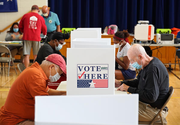 Voters fill out their ballots for Missouri's primary election at Old Bonhomme Elementary School in Olivette on Tuesday morning.