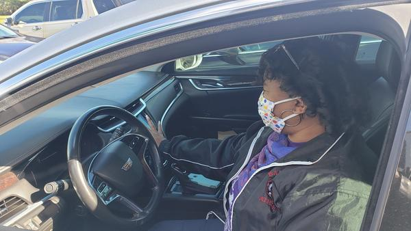 Jeneen Smith-Underwood sitting in her car during a recent church service.