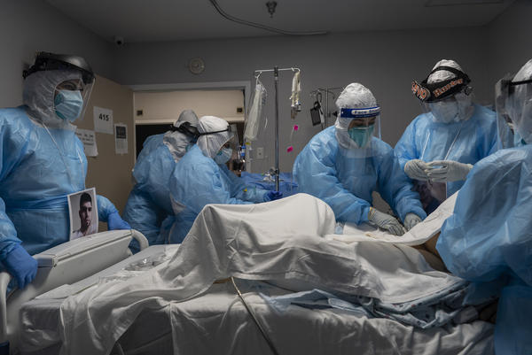 Medical staff members treat a patient with COVID-19 last week in the intensive care unit of United Memorial Medical Center in Houston. Once a COVID-19 vaccine is available, experts say immunizing health workers first is the best way to curb deaths and stop transmission.