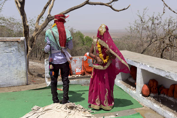 A child bride, age 14, participated in wedding rituals in a Hindu temple in India's Madhya Pradesh state in 2017. An estimated 1.5 million underage girls marry each year in India, according to the United Nations. The pandemic appears to be causing a spike in numbers.