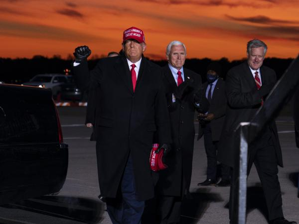 Mark Meadows travels with President Trump and Vice President Pence to a rally in Traverse City, Mich., on Sunday.