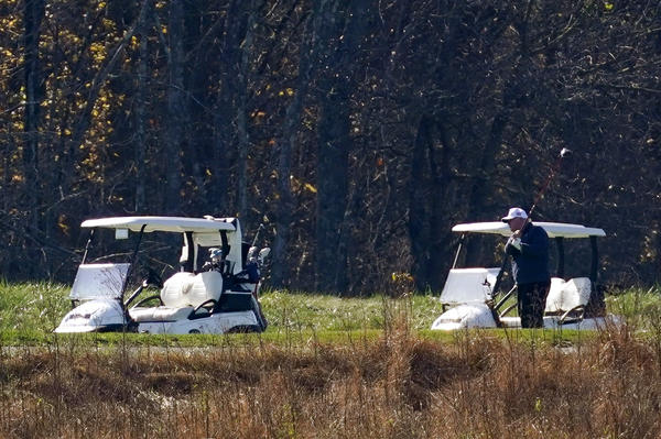 President Trump plays golf at the Trump National Golf Course on Saturday in Sterling, Va.
