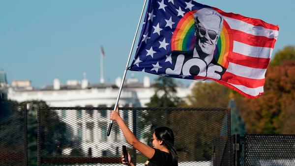 A woman waves a Joe Biden flag during celebrations of his presidential victory on Black Lives Matter Plaza across from the White House on Saturday.