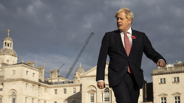 British Prime Minister Boris Johnson walks across Horse Guards Parade to Admiralty House on Friday in London.