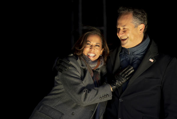 Sen. Kamala Harris and her husband, Doug Emhoff, embrace onstage at a drive-in Election Day eve rally in Philadelphia.
