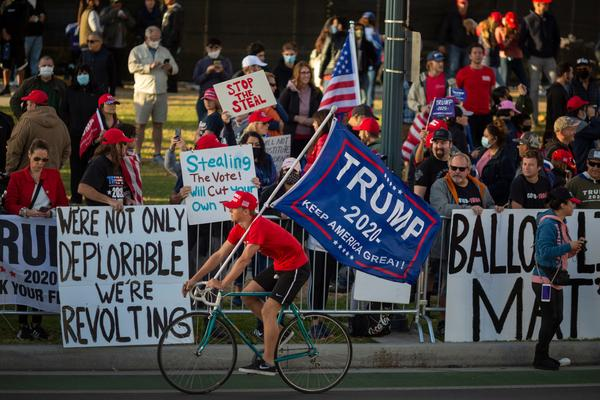 Supporters of President Trump rally in Beverly Hills, Calif., on Saturday after Democratic nominee Joe Biden was declared to have won the 2020 presidential election.