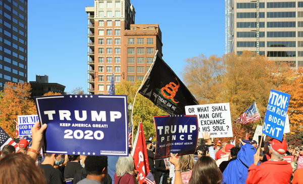 Signs and flags at the pro-Trump rally at the Ohio Statehouse on Saturday, November 7, 2020.