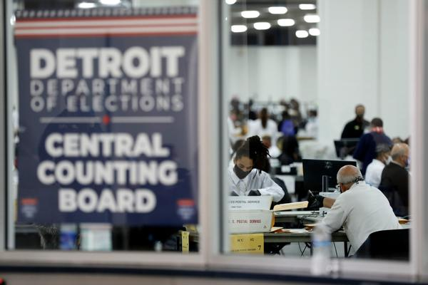 Detroit election workers work on counting absentee ballots for the 2020 general election at TCF Center on November 4, 2020 in Detroit, Michigan. (Jeff Kowalsky/AFP via Getty Images)