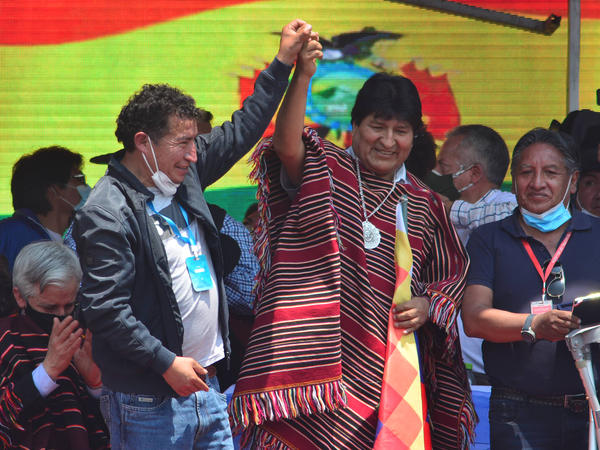 Former Bolivian President Evo Morales (middle) greets supporters during a welcoming ceremony after he crossed the border from Argentina after one year in exile on Monday, in Villazón, Bolivia.