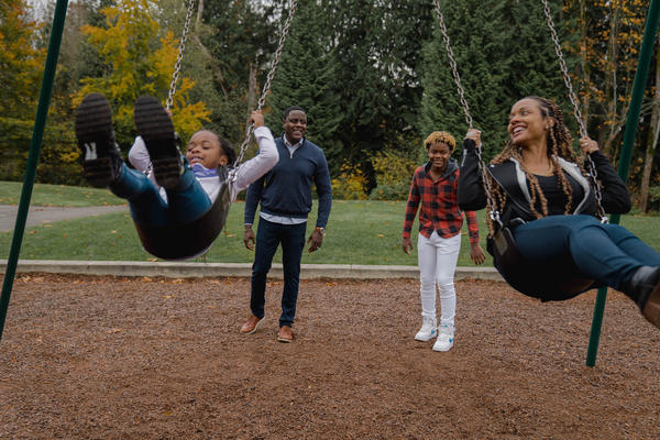 Will Station, a vice president at Boeing (second from left) plays with his children, Taylor (left) and Jaden, and his wife April, near their home in Newcastle, Wash. During the pandemic, Station has not traveled for work, so he's spent a lot more time at home with his family.