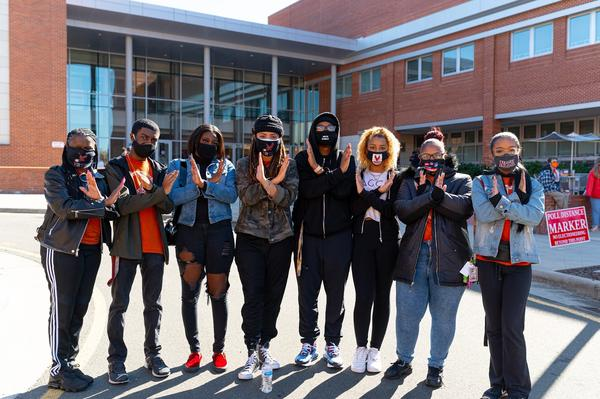 Students and faculty at North Carolina Central University make the Eagles hand sign at their polling site on Election Day.