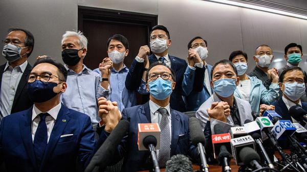 Pro-democracy lawmakers at the start of a news conference in a Legislative Council office in Hong Kong on Wednesday. The legislators are resigning en masse over a new law from Beijing that led to the ouster of four of their fellow lawmakers.