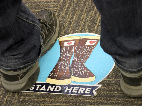Social distancing floor stickers are seen at a mall last month during early voting in Anchorage, Alaska.