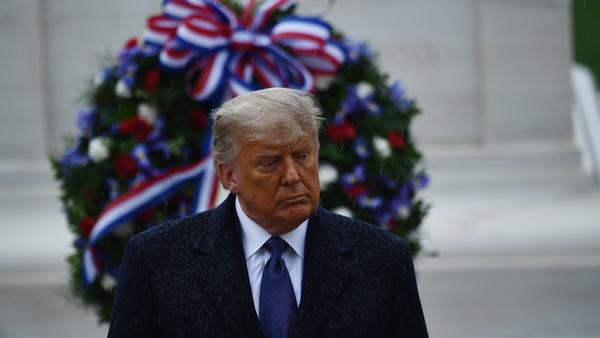 President Trump attends a Veterans Day wreath-laying ceremony at Arlington National Cemetery, in his first official appearance since Election Day.