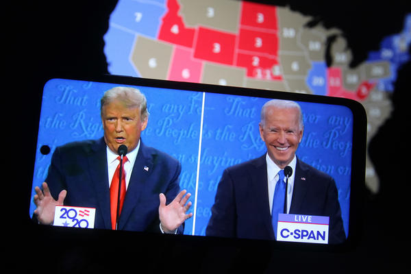 Some major final steps for the 2020 census are set to take place during the transition from President Trump to President-elect Joe Biden, who both appear above on a smartphone displaying the final presidential debate in October.