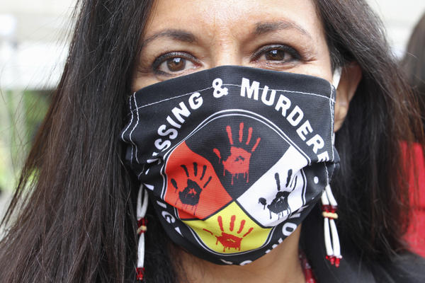 Jeannie Hovland, the deputy assistant secretary for Native American Affairs for the U.S. Department of Health and Human Services, poses with a Missing and Murdered Indigenous Women mask, Wednesday, Aug. 26, 2020, in Anchorage, Alaska. She attended the opening of a Lady Justice Task Force cold case office in Anchorage, which will investigate missing and murdered Indigenous women
