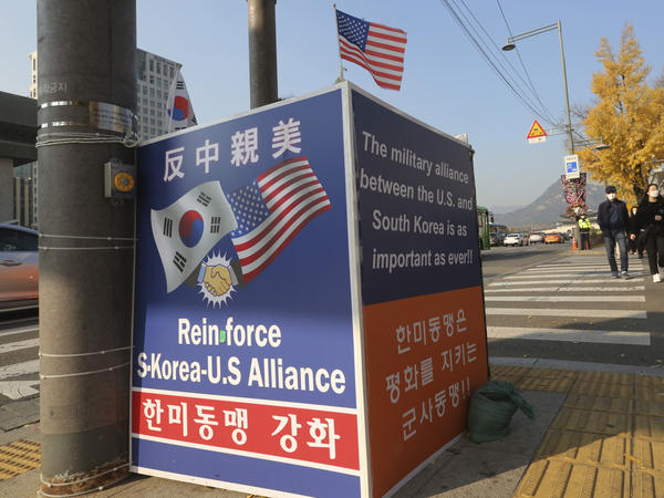"A billboard supporting the alliance between South Korea and the U.S. is displayed near the U.S. Embassy in Seoul on Thursday. The banner at top reads, ""Anti-China and Pro-the U.S."""