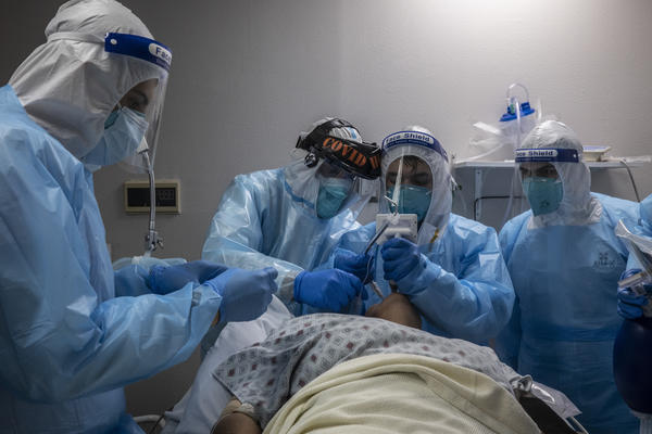 Medical staff treat a patient in the COVID-19 intensive care unit at United Memorial Medical Center in Houston on Nov. 10.