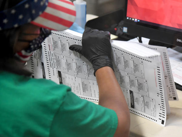 A Clark County election worker scans mail-in ballots on Nov. 7 in North Las Vegas, Nevada.