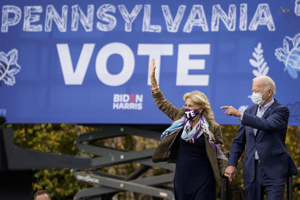 Joe Biden and his wife, Jill Biden, arrive for a drive-in campaign rally last month at Bucks County Community College near Philadelphia. Bucks County and three other suburban Philadelphia counties helped the president-elect win the swing state.