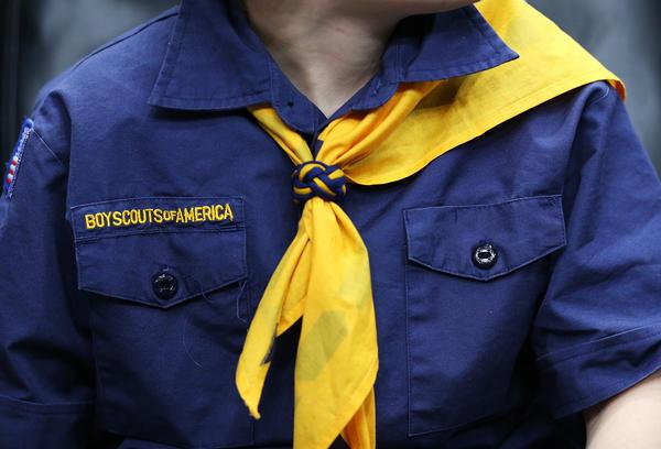 A boy scout in uniform.