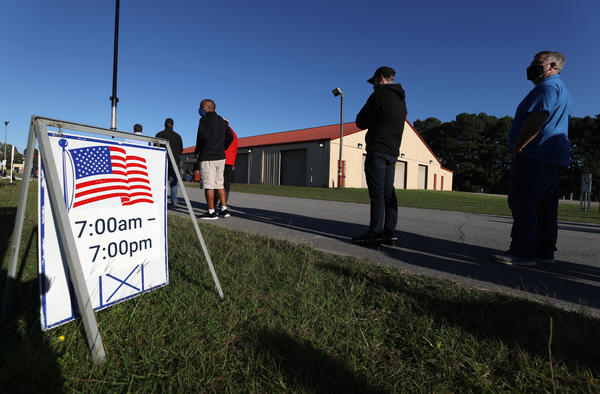 Voters line up at Gwinnett County Fairgrounds last month in Lawrenceville, Ga., to cast their ballot on the final day of early voting in Georgia.