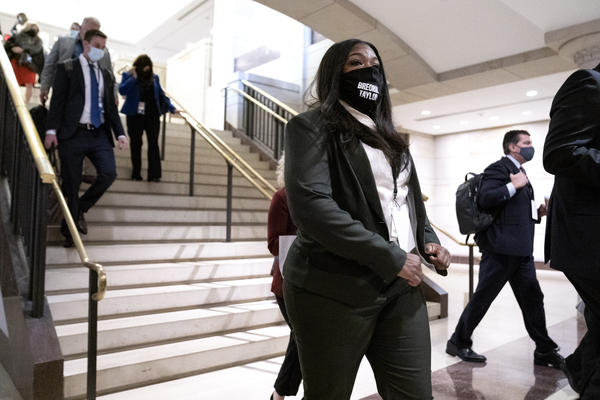 Rep.-elect Cori Bush, a Democrat from Missouri, arrives at a new member briefing at the Capitol on Friday. With the pandemic raging, the orientation bore little resemblance to previous sessions. But lawmakers will have access to coronavirus testing.