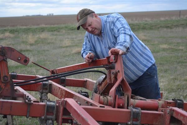 Sen. Jon Tester, D-Mont., works on his farm in Big Sandy, Mont., in 2017.