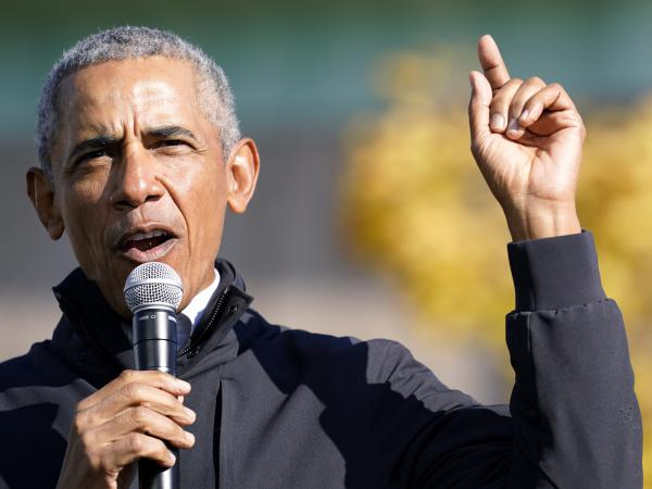 "Former President Barack Obama speaks at a rally for Joe Biden in Flint, Mich. on Oct. 31. In an interview with NPR, Obama said Trump was ""denying reality"" by refusing to concede the election to Biden."