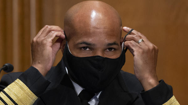 "Surgeon General Jerome Adams, pictured on Capitol Hill on Sept. 9, says the Trump administration coronavirus task force is sharing information with ""everyone,"" despite claims that they are not sharing information with the Biden transition team."