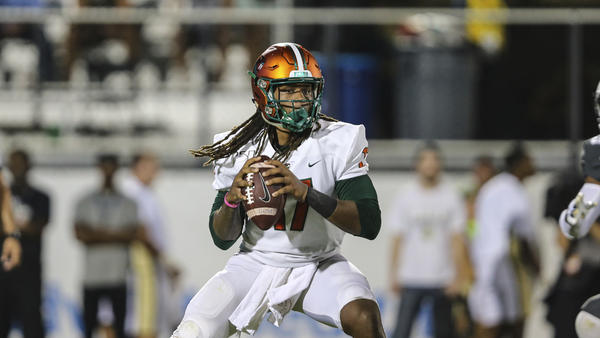 Florida A&M quarterback Rasean McKay (17) looks for a receiver during an NCAA football game against Central Florida on Thursday, Aug. 29, 2019 in Orlando, Fla. (AP Photo/Gary McCullough)