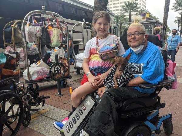 Eric Hogan and his niece wait to board a bus to the Alexandria megashelter after spending more than two months as evacuees at the Sheraton New Orleans.