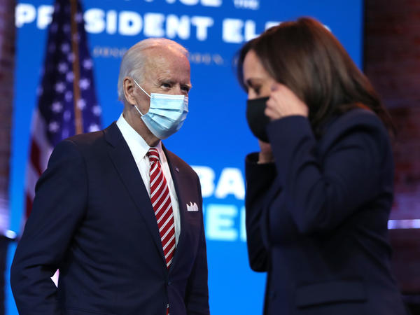 President-elect Joe Biden walks by Vice President-elect Kamala Harris before delivering remarks on his plan for economic recovery under his incoming administration.