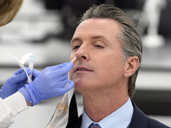 "California Gov. Gavin Newsom, pictured receiving a coronavirus test on Oct. 30, apologized to residents on Monday for attending a birthday party with too many guests. ""I need to preach and practice, not just preach,"" he said."
