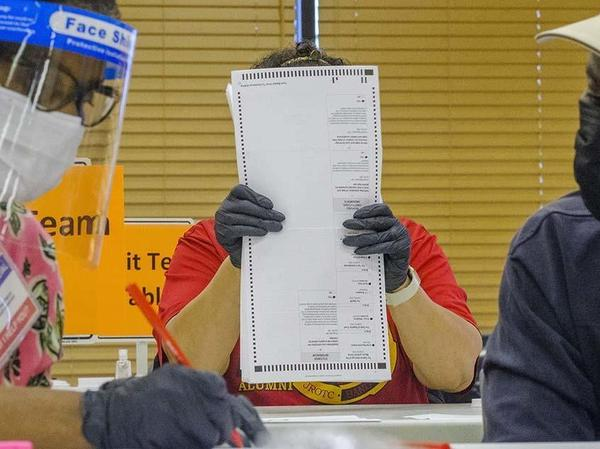 Fourteen auditors began the manual recount of around 71,000 presidential ballots in Macon, Ga., on Friday, part of a statewide recount of about 5 million votes cast across Georgia.