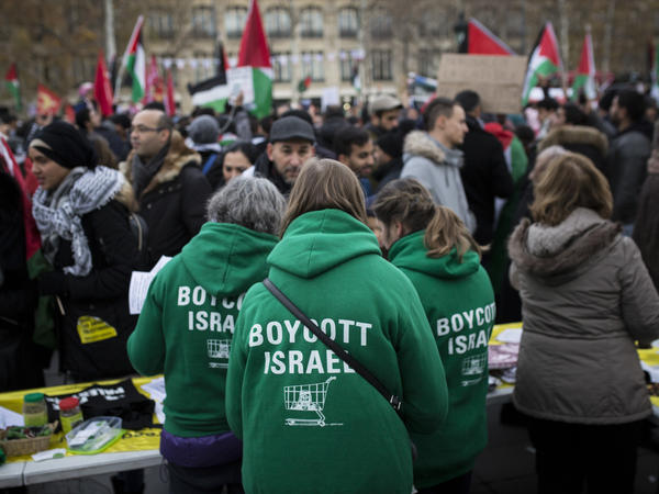 Demonstrators advocating the movement to boycott, divest from and sanction Israel, known as BDS, gather for a protest last year in Paris. On Thursday, U.S. Secretary of State Mike Pompeo announced a new policy specifically countering the global BDS campaign.