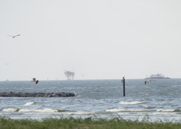 Oil rigs are visible off the coast of Grand Isle, La.