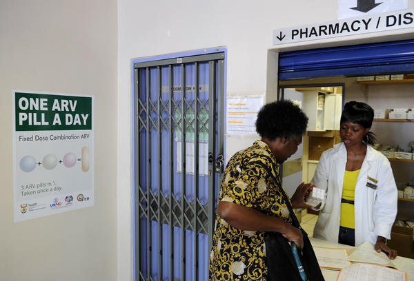 A woman receives medication at a clinic offering antiretroviral drugs for HIV patients in Ga-Rankuwa, South Africa.