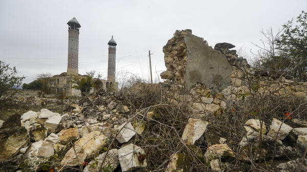A mosque is seen through ruins in Aghdam on Thursday, just before the formal entry of Azerbaijani forces. As part of a recent peace agreement, Armenia ceded control of several regions in and around the disputed territory of Nagorno-Karabakh.