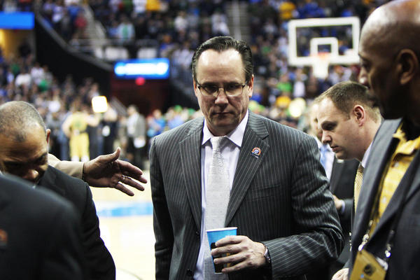 Gree Marshall, center, has resigned as Wichita State's men's basketball coach after media reports he had been abusive toward staff and players.