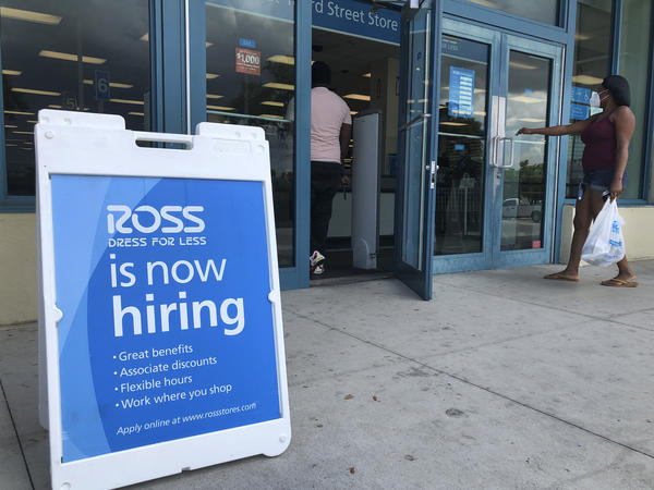 """FILE - In this July 8, 2020, file photo, a """"Now Hiring"""" sign sits outside a Ross Dress for Less store, in North Miami Beach, Fla. (AP Photo/Wilfredo Lee, File)"""