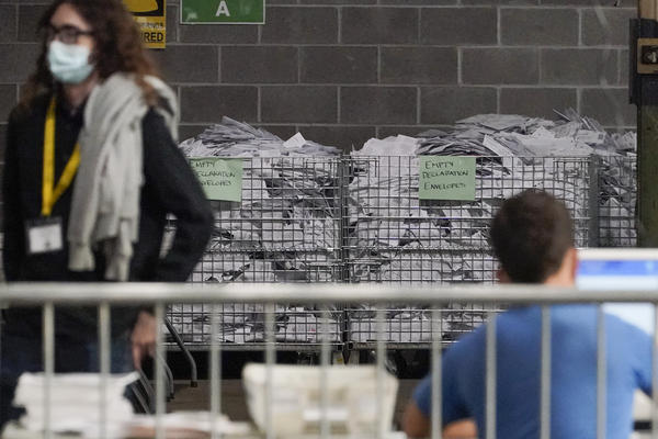 Election office workers process ballots at the Allegheny County elections returns warehouse in Pittsburgh, earlier this month.