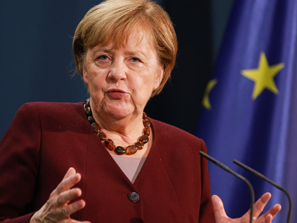 German Chancellor Angela Merkel speaks to the media following her participation in a virtual summit of G20 nations in which she expressed concern over a lack of plan to prepare coronavirus vaccinations for poorer countries.