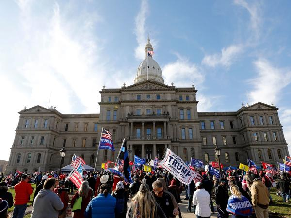 Protesters gather in support of President Trump on Nov. 14 at the Michigan Capitol in Lansing. Trump and his allies have baselessly alleged widespread voter fraud was to blame for the president's election loss.