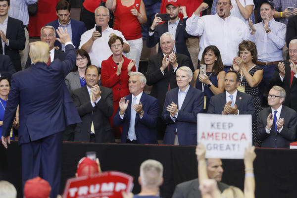 President Trump waves to a crowd featuring from right, Ohio Gov. Mike DeWine, then-Kentucky Gov. Matt Bevin, Sen. Rob Portman, R-Ohio, and Rep. Brad Wenstrup, R-Ohio, at a campaign rally at U.S. Bank Arena, Thursday, Aug. 1, 2019, in Cincinnati.