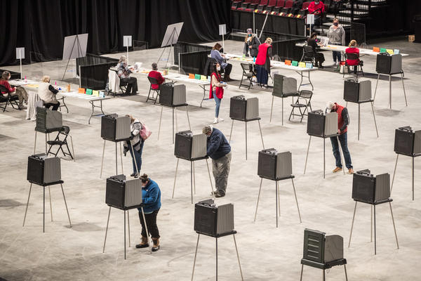 Voters fill out and cast their ballots on Election Day in Bangor, Maine. More than 150 million votes were cast in 2020, the highest voter turnout rate in more than a century.