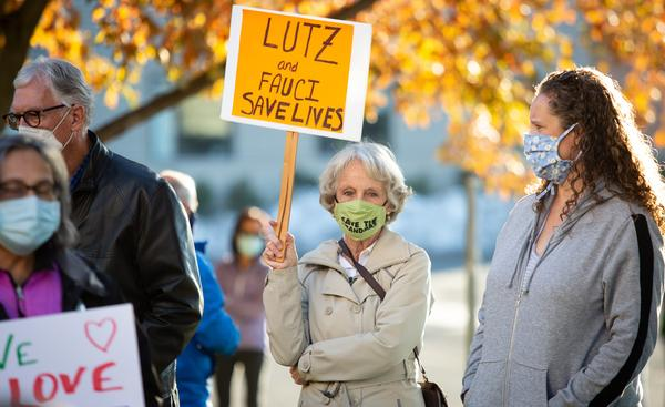 Community members in the Spokane area demonstrated in favor of county health officer Dr. Bob Lutz after he was forced out and later fired by the county board of health.