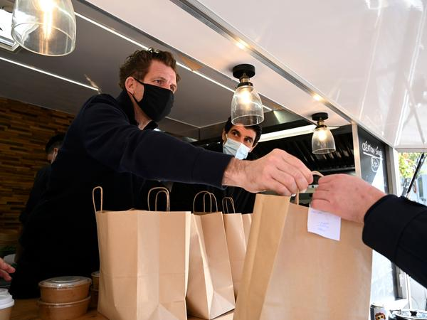 France announced some COVID-19 restrictions will ease this week after the country passed the peak of the virus's second wave. Restaurants will remain closed until January.