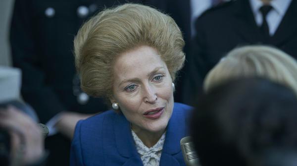 Gillian Anderson portrays British Prime Minister Margaret Thatcher in <em>The Crown. </em>